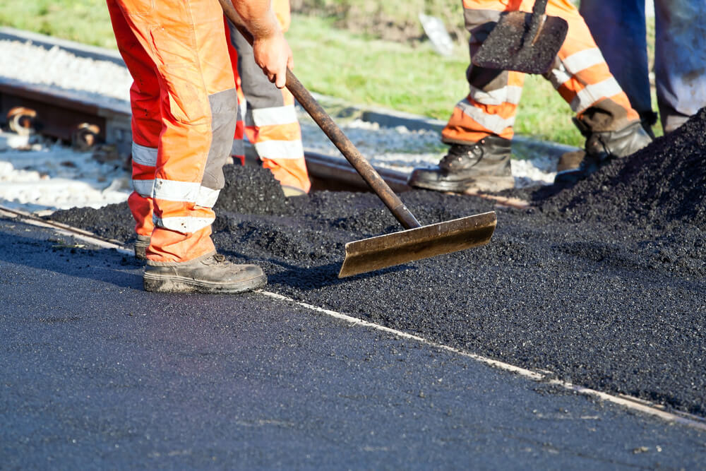 Why is asphalt used to make a road surface?